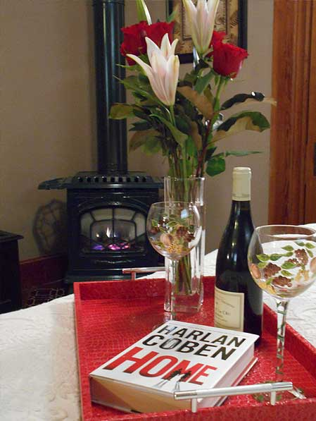 Wine, book, and flowers on a tray
